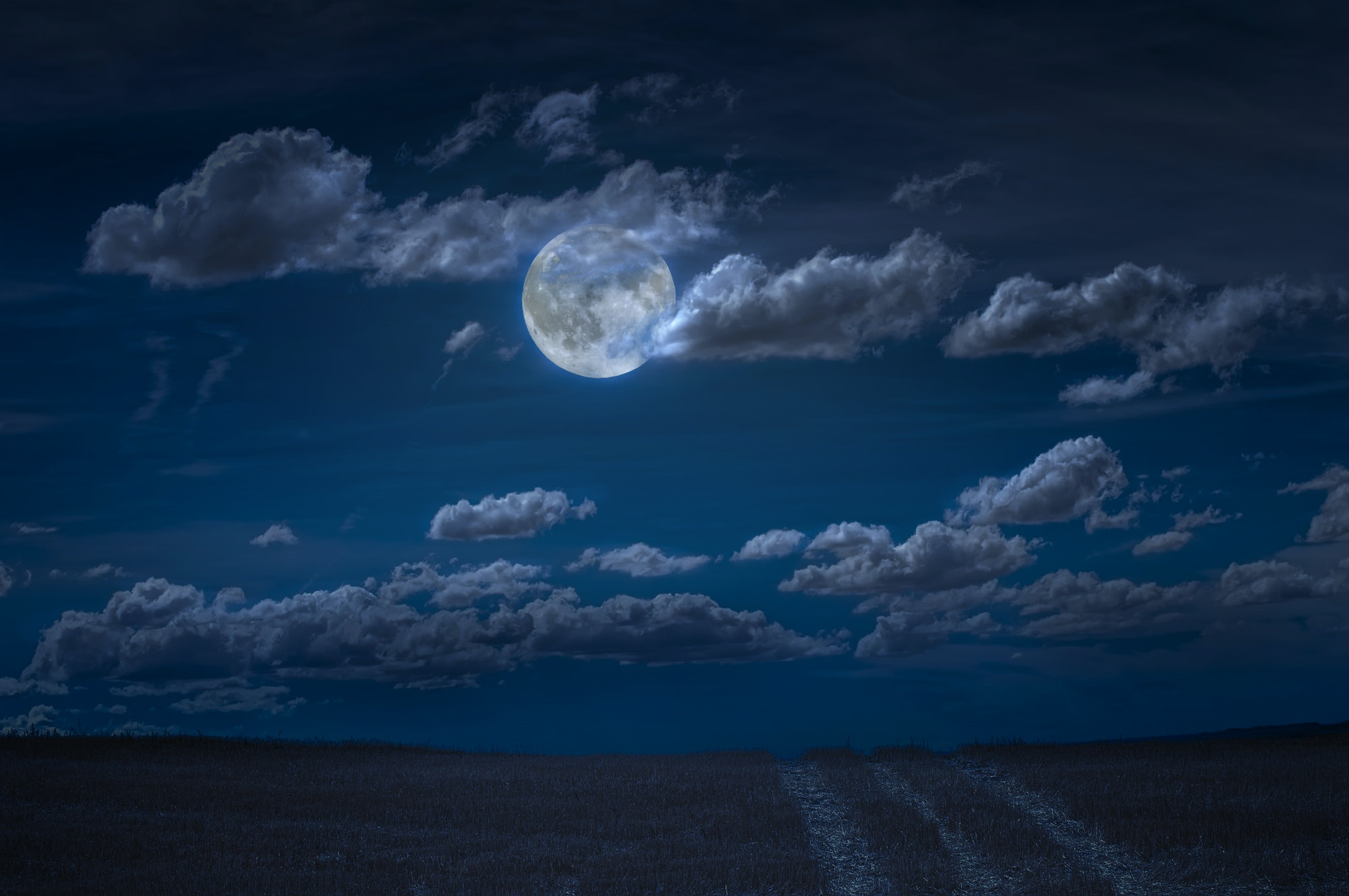 Moon and clouds in the night. Moonlight and road background.